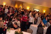 Employees with Durham-based Quintiles get together for a large holiday shindig.