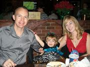 Wendy Coulter, CEO of Hummingbird Creative Group, shares a moment with her husband, James, and daughter, Callie, during the company's holiday party.