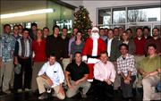 The gang from Strata Solar in Chapel Hill get together for a group photo during the holidays.