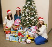 Jamie Bailey, Erin Byers and Whitney Ranking (from left to right) with Kerr Drug take part in the Toys for Tots program during the holidays.