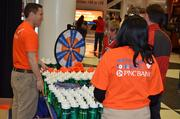 PNC employees were giving away free prizes including t-shirts and water bottles during the game.