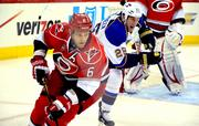 The Carolina Hurricanes' Tim Gleason keeps his eye on the puck during the game.