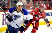 The St. Louis Blues' Chris Stewart goes after the puck.
