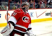 Cam Ward recorded the 200th win and 20th shutout of his carrier against the league's top team, the St. Louis Blues.