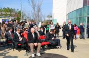 A crowd of local media and PNC employees gather to witness the unveiling.