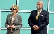 Gov. Beverly Perdue stands next to Carolina Hurricanes majority owner Peter Karmanos.