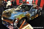 """The American Pride Camaro had a lot of admirers at the auto expo. Artist Mickey Harris made the car come to life with a representation of """"America."""""""