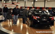 Attendees take a look at Toyota's 2012 Camry.