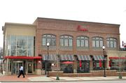 A front view of the two-story Chick-Fil-A from across Cameron Street in Cameron Village.
