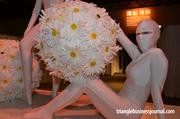 Upon entering the gala, a couple of performance artists methodically moved around on a pedestal with giant flower spheres.