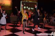 """Various acts were scattered between the live auction at the Triangle Wine Experience. This group of dancers is performing to the tune of the Rocky Horror Picture Show classic song, """"Time Warp."""""""