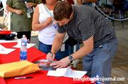 Chad LaRose signs autographs for his fans at the Salue the Troops event.