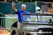 Voice of the Duke Blue Devils, Bob Harris, arrives at the event in a military jeep.