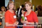 Jackson Lewis LLP's Julie Allen talks with WIB winner Patricia Holland.