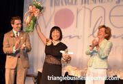 Ping Fu, center, celebrates her lifetime achievement award with TBJ Publisher Bryan Hamilton, and previous lifetime achievement winner Laura Bingham.