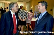 Phil Williams with The Leadership Trust Inc., left, talks with Sandler Training's Rich Gorman at the Women in Business event.