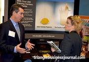 Rich Gorman, with Sandler Training, talks business with Hughes Pittman & Gupton's Shannon Cook.