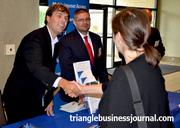 Time Warner Cable's Justin Purdy greets an attendee at the Women in Business expo.