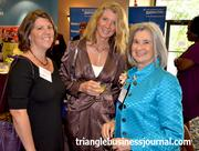 Diana Whitney, right, who is one of this year's WIB winners, and daughter Shara Kaplin, left, mingle with Gwynn Sullivan of National Hospice, center.