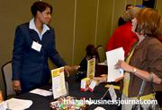 Progress Energy's Donna Ruffin discusses energy conservation during the Women in Business expo.