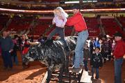A popular event in the Kid Zone was the opportunity to sit on top of a replica bull.