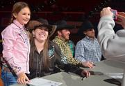 Other kids stood in line to get their photo taken with some of the star performances of the rodeo.