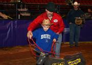 This little tyke roped his bull in his first try.