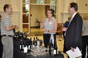Alec Robson with Dionysus discusses wine with Patsy Pierce and Charles Caldwell.