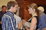 Bryce Little and Cara Knight compare notes on the wine they're tasting.