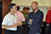 Matthew Kane, left, talks with Wine to Water founder Doc Hendley.