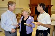 Charles Knight, left, talks with Bonnie Liam and Matthew Kane at the Wine to Water fundraiser, hosted by the Rotaract Club of Raleigh.