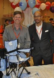 Bruce Fisher and Shawn Braxton don UNC colors for VMWare (NYSE: VMW).