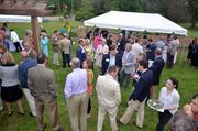 The attendees at the Farm to Table fundraiser endured the chilly May evening.