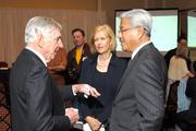 Dole Foods' David Murdock walks through his vision with Duke Health's Victor Dzau as Castle and Cooke's Lynne Safrit listens intently.