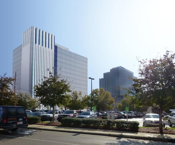A digital rendering of the proposed 19-story tall Tower Two office building (right) at North Hills as it would be viewed from Six Forks Road. The existing 17-story CapTrust Tower building is on the right.