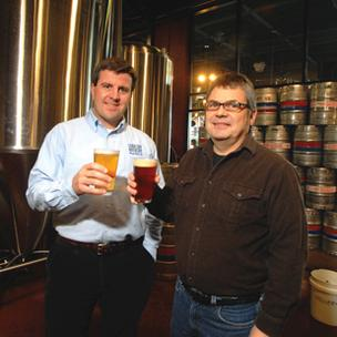 Carolina Brewery owner Robert Poitras and brewer Jon Connolly in 2010 file photo.
