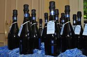 Sponsor Grinnell Leadership awarded this year's winners a nice bottle of sparkling wine for their accomplishments.