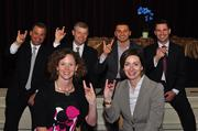 A handful of NCSU alums, all winners in this year's 40 Under 40, throw up the wolf in salute to their achievements – and to the Pack!