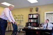 Adam Abram with Scott Custer in his office.