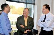 Adam Abram Conferring with Bandwidth's John Murdock (left) and investor Steve Lerner (center).