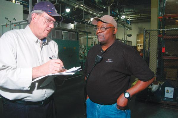 Will Collins, left, with Linwood Bethel at the AW North Carolina transmission plant in Durham.