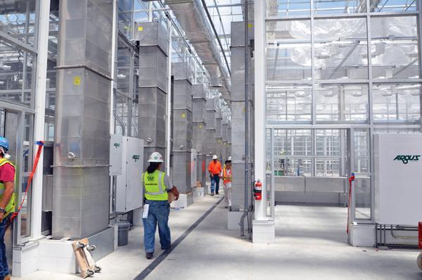 Construction is near completion on a massive greenhouse for Bayer CropScience.