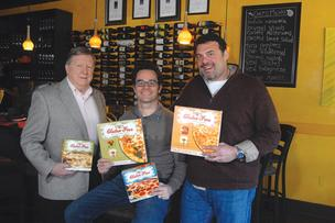 Bella Monica execs, from left, CEO Jim Meese, Vice President Trevor Chambers and President Corbett Monica and their pizzas.