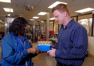 Michael Springer, senior manager of manufacturing in Durham, goes over samples with  Brenda Perry.