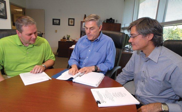 Chimerix executives Roy Ware, left, CEO Ken Moch and David Bridge.