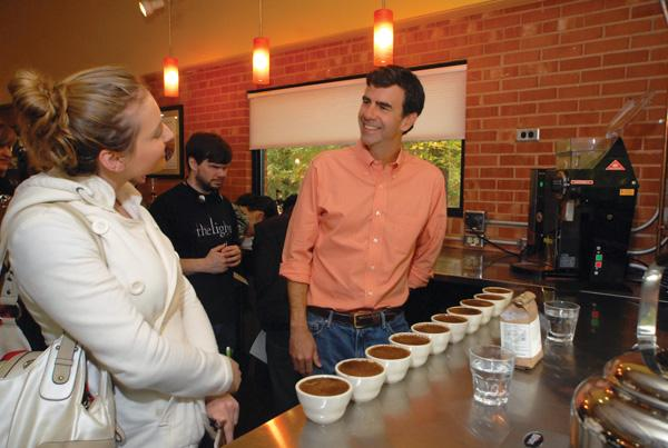 Brett Smith talks coffee with Oksana Nechitailo.