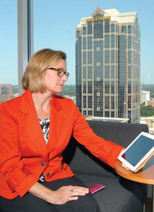 Poyner Spruill CIO Ellen Kinsinger with her iPad at work.