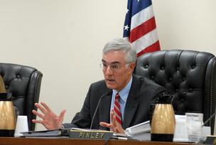Ed Finley presides over merger hearings.