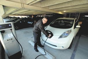 "John Davis ""fills"" his car at a charging station at Biogen Idec."