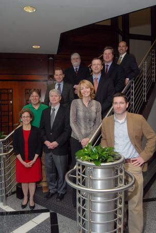 "The partners are, clockwise from far left, Stephanie Powell, W.H. ""Kip"" Johnson, Mack Paul, William J. Brian Jr., Grayson S. Hale, Gene Jones, Patrick L. Byker, Jason L. Barron, Jennifer L. Collins and Kenneth G. Carroll."